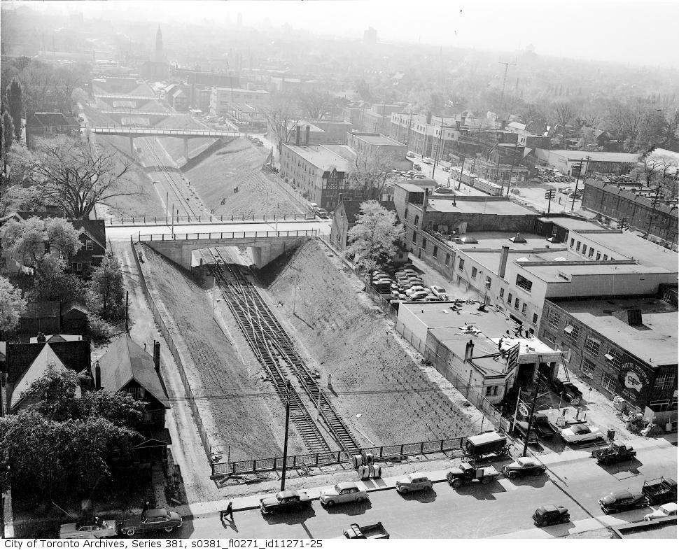 The subway had a direct impact on the urban landscape. This photo, taken in October 1953, shows an open cut section of the Yonge Street subway. Architect Eric Arthur compared subway open cuts to the city's ravines. City of Toronto Archives, Fonds 1128, Series 381, File 271, id11271-25