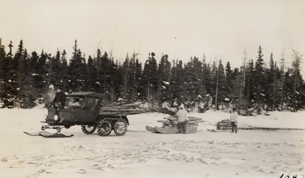 Snowmobile hauling wood to camp, 1924-1937, Labrador. Photographer: Donald Baxter Macmillan. Photo reproduced with the permission of Peary-Macmillan Arctic Museum (Bowdoin college, Brunswick, Maine, USA).