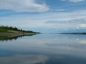 The Mackenzie River on a calm day. Photo credit: Anson Chappell.