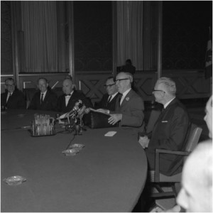 Prime Minister Lester B. Pearson addressing the Science Council of Canada. July 5, 1966. Pearson is seated at the podium. Omond Solandt, the Council's first chairperson is seated on Pearson's right. Solandt was the Chancellor of the University of Toronto, a former head of Defence Research, and a personal friend of Pearson.  Library and Archives Canada/Duncan Cameron fonds/e011093238 (reproduced with permission).