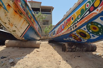 An underside view of two pirogue fishing vessels