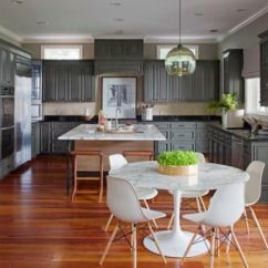Light Kitchen Table Wall Cabinets Pendant Creates A Modern Centerpiece In Savannah Home