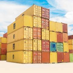 Five rows of yellow, brown, and blue shipping containers
