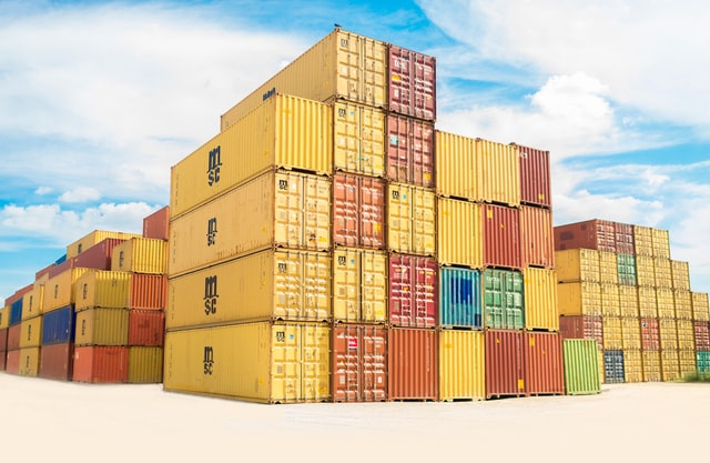 Five rows of yellow shipping containers