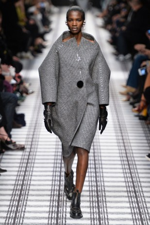 Fall 2015 The cocoonlike shapes and B brooches reflected Wang's respect of the archives, and Cathy Horyn proclaimed it his best work at Balenciaga yet.