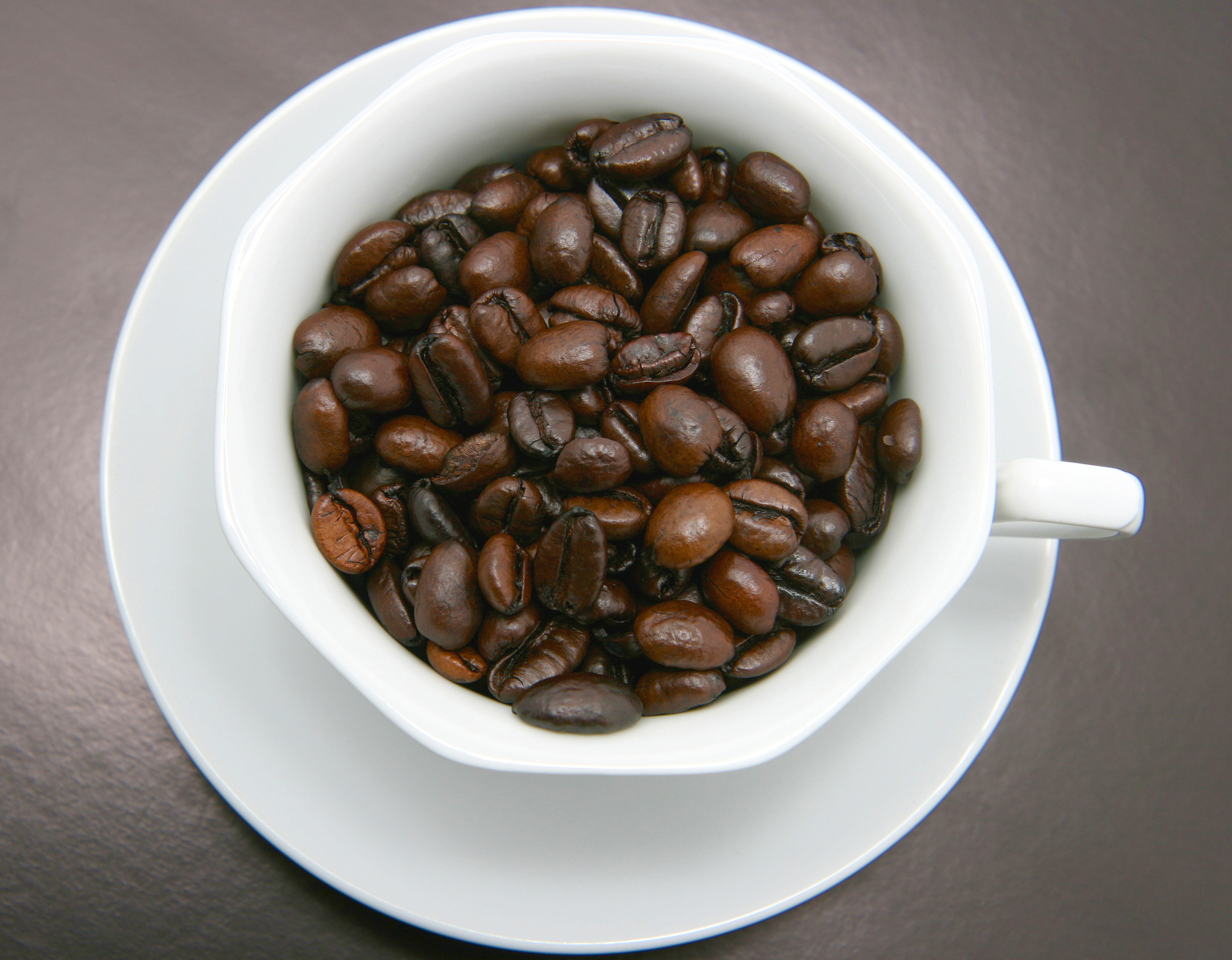 Cup Filled With Coffee Beans   Nicholas C. Rossis