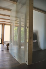 opaque glass, smoked oak and laminate timber frame