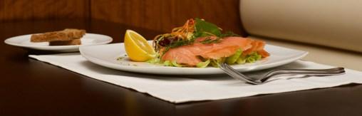 Panorama of smoked salmon platter and toast