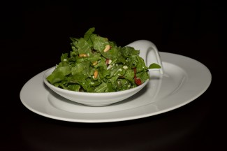 Rocket salad with cheese and pine nuts