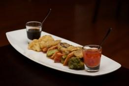 Tempura vegetable platter with glasses of sauce