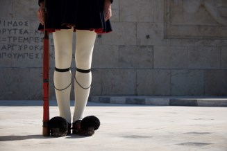 Legs of Greek presidential guardsman with rifle