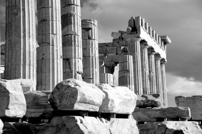 Mono piles of stones before ruined Parthenon