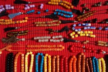 Necklaces of plastic beads on red cloth