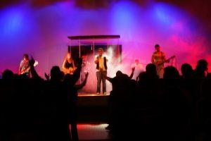A group of teens worshiping God