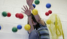 Student being hammered by dodge balls