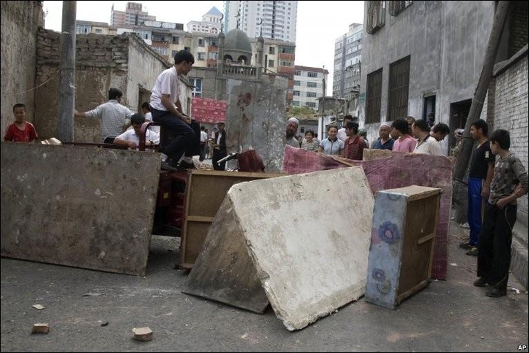 Uighur residents blocking off street