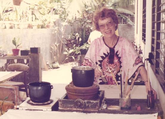 Mom behind the wax pots