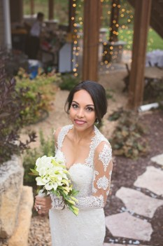 bride in custom lace gown with calla lilies at outdoor wedding portrait by MN photographer Nicki Joachim Photography Owatonna Minnesota