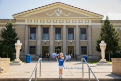 girl cheerleader showing school spirit wearing blue in child's portrait by MN family and child photographer Nicki Joachim Photography