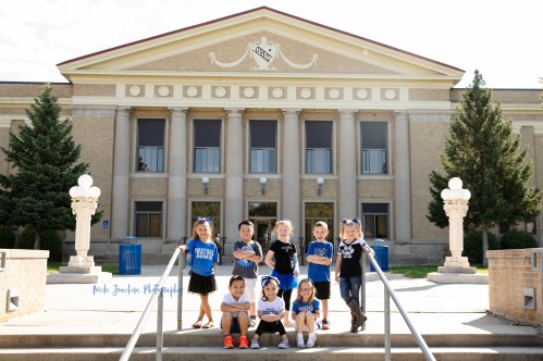 happy kids showing school spirit in child portrait by MN family and child portrait photographer Nicki Joachim Photography of Owatonna Minnesota