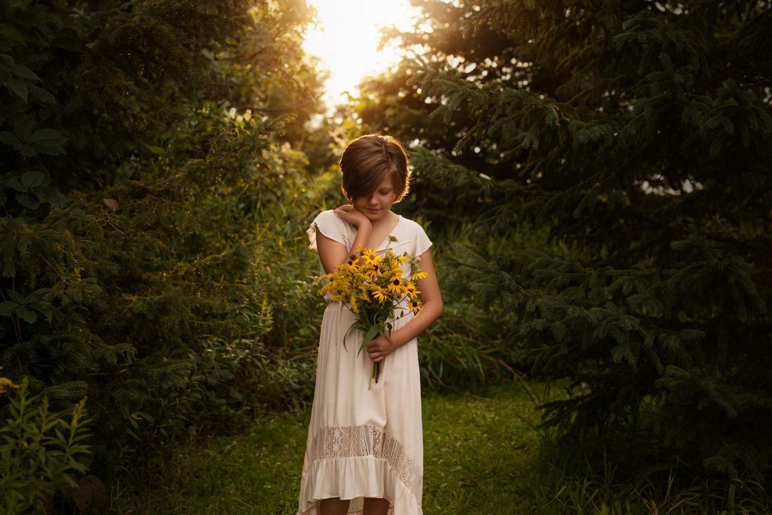 styled girl with flowers at sunset portrait by MN photographer Nicki Joachim Photography Owatonna Minnesota