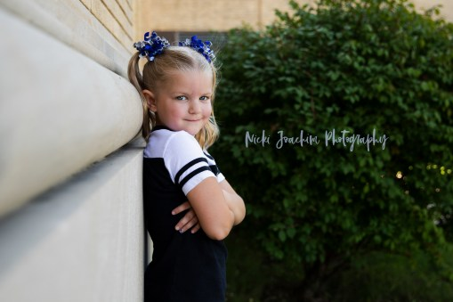 young girl showing school spirit child portrait by MN family and child photographer Nicki Joachim Photography of Owatonna Minnesota