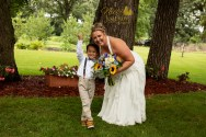 Bride and ring bearer laughing in outdoor country chic wedding portrait by MN wedding photographer Nicki Joachim Photography of Owatonna Minnesota