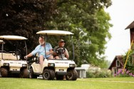 golf cart transportation at fun country chic wedding portrait by MN wedding photographer Nicki Joachim Photography of Owatonna Minnesota