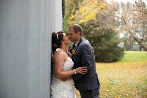 Wedding portrait of bride and groom in rustic outdoor country wedding in Kasson MN by MN Wedding Photographer Nicki Joachim Photography of Owatonna, MInnesota