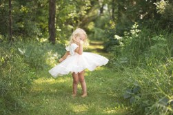 girl twirling in her dress outdoors in a natural light lifestyle potrait by MN Child Photographer Nicki Joachim Photography of Owatonna Minnesota