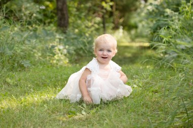 toddler girl in dollcake dress in outdoor princess session in a beautiful child portrait by MN Family Photographer Nicki Joachim Photography of Owatonna Minnesota
