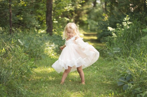 young girl twirling in dollcake dress in princess photo session in a beautiful child portrait by MN Child Photographer Nicki Joachim Photography of Owatonna Minnesota
