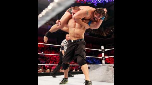 WWE Cena slams Rusef into steel stairs