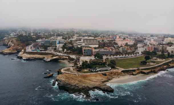 aerial photography of buildings beside of sea
