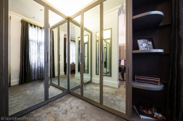 Walk-in wardrobe featuring lots of mirrors