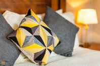Abstract geometric cushion cover, unique to the room