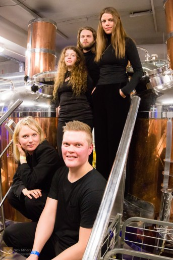 At the invitation of the staff, the band pose for a photo in the brewery's workshop
