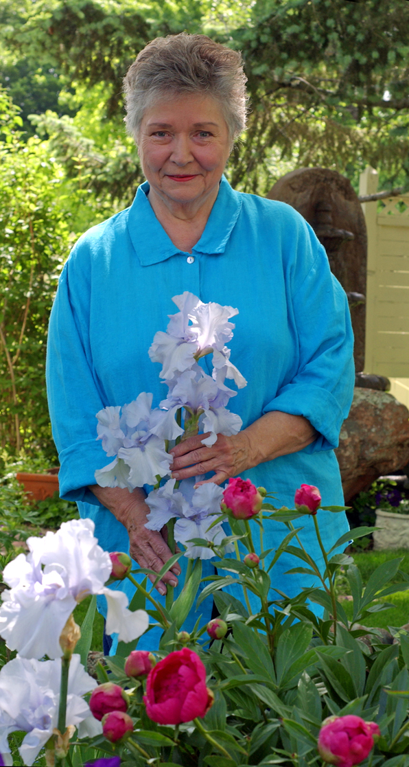 A favorite photo of Mom in her sanctuary of flowers.