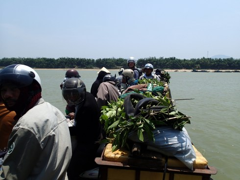 Our first ferry crossing. I am six inches taller than everyone else in Vietnam.