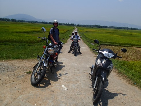 Me and my hog on the left, Rae and Tuong in the center, Pam's lame moped on the right. (It was actually faster than my motorcycle.)