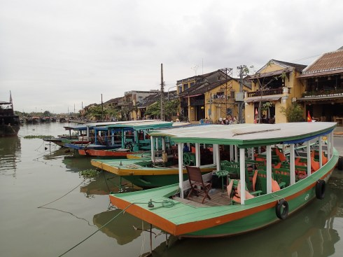 "There are tons of cafes and restaurants along the river. You can rent one of these boats and tool around if you like. ""Mistah! Moto-boat! Five dollah, half a hour! Hey mistah!"""