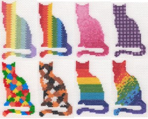 eight cross stitch cats