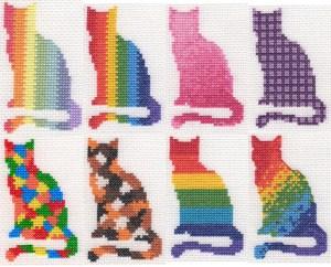 eight cross stitch cats