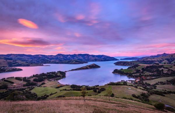 Sunrise over Akaroa Harbour New Zealand photo by Nico Babot