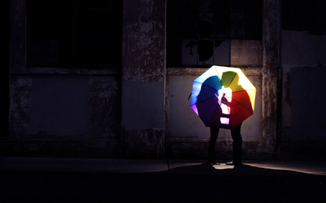 Image: Couple Kissing Behind Umbrella