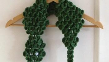 crocodile scarf open on hanger.