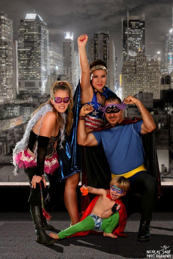 family wearing superhero costumes