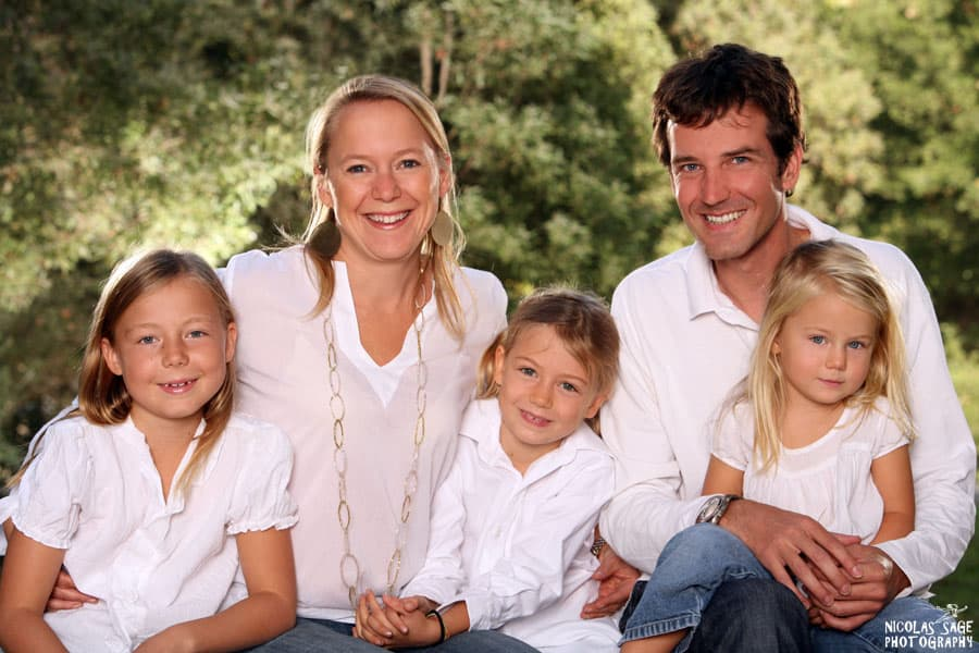 family portrait of five wearing white shirts three daughters in Santa Monica