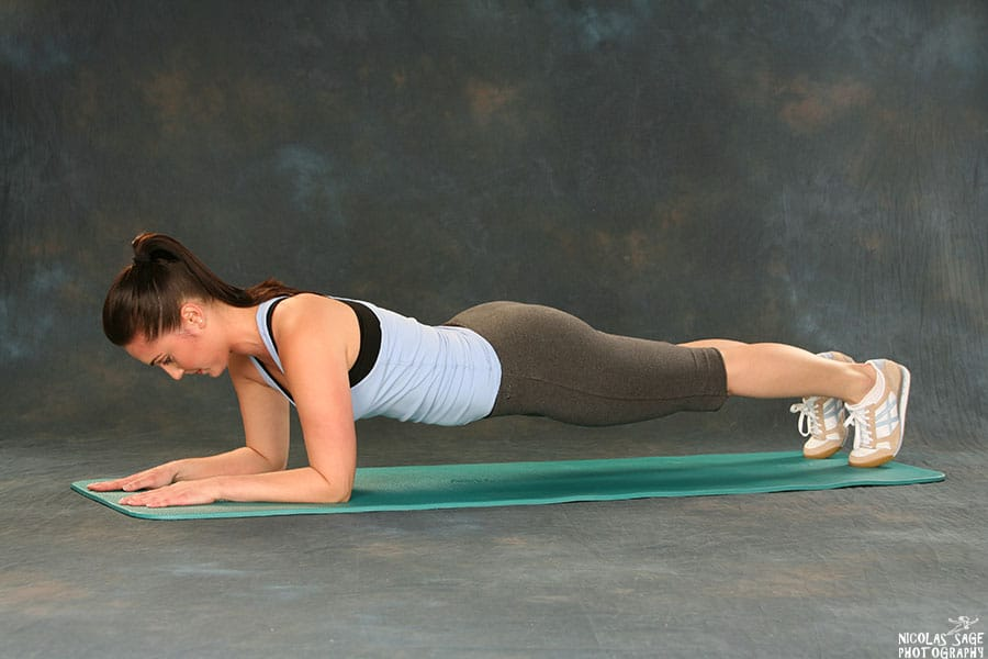 woman demonstrating plank exercise los angeles fitness photography nicolas sage