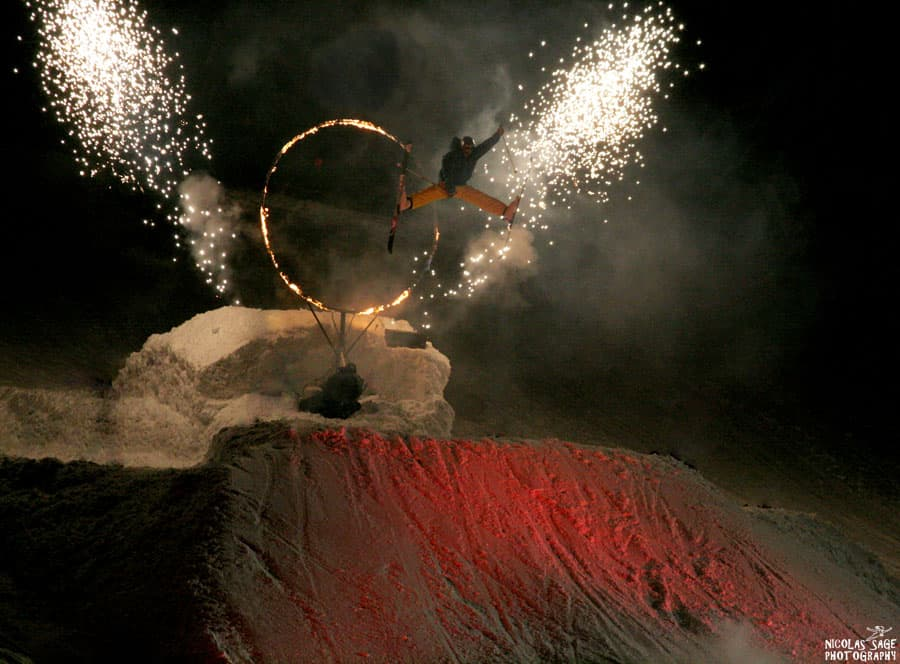 skier jumping through ring of fire in whistler photo by nicolas sage